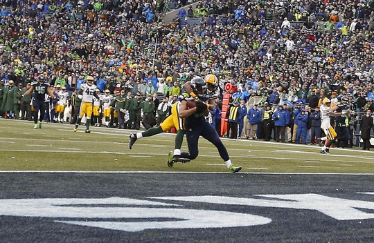 January 18, 2015; Seattle, WA, USA; Seattle Seahawks wide receiver Jermaine Kearse (15) runs in the ball for the game winning touchdown against the Green Bay Packers during the overtime period in the NFC Championship game at CenturyLink Field. Mandatory Credit: Joe Nicholson-USA TODAY Sports