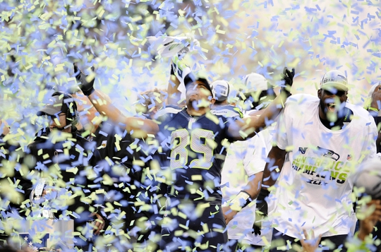 Jan 18, 2015; Seattle, WA, USA; Seattle Seahawks wide receiver Doug Baldwin (89) celebrates as the confetti pours onto the field following their victory over the Green Bay Packers in the NFC Championship Game at CenturyLink Field. The Seahawks defeated the Packers 28-22 in overtime. Mandatory Credit: Steven Bisig-USA TODAY Sports