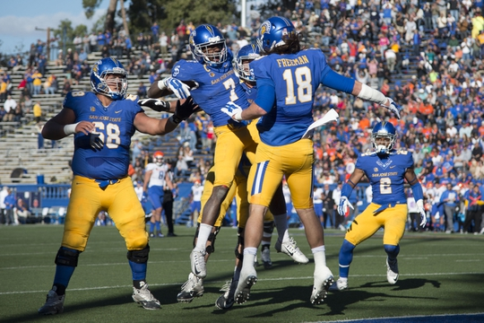 November 27, 2015; San Jose, CA, USA; San Jose State Spartans tight end Billy Freeman (18) is congratulated by running back Tyler Ervin (7) for scoring a touchdown against the Boise State Broncos during the second quarter at Spartan Stadium. Mandatory Credit: Kyle Terada-USA TODAY Sports
