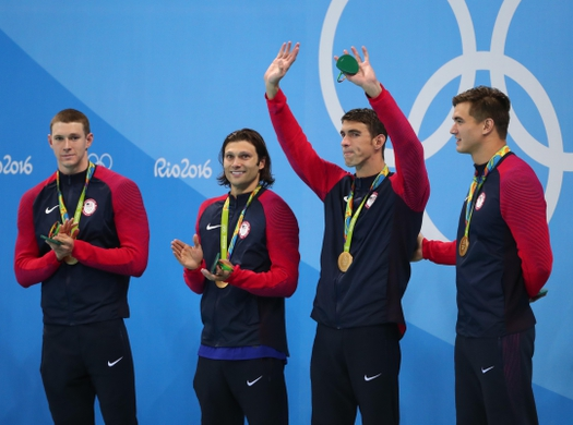 Aug 13, 2016; Rio de Janeiro, Brazil; Ryan Murphy (USA) , Cody Miller (USA) , Michael Phelps (USA) and Nathan Adrian (USA) on the podium after the men's 4x100m medley relay final in the Rio 2016 Summer Olympic Games at Olympic Aquatics Stadium. Mandatory Credit: Rob Schumacher-USA TODAY Sports