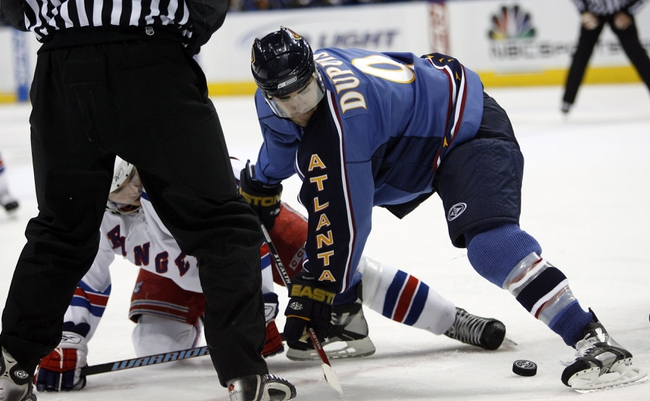 Apr 14, 2007; Atlanta, GA, USA; Atlanta Thrashers forward (9) Pascal Dupuis knocks down New York Rangers forward (25) Petr Prucha after a face off in the second period at Philips Arena in the Eastern Conference Quarterfinal playoff series. The Rangers defeated the Thrashers 2 to 1 to take a two games to none lead in the best of seven series. Mandatory Credit: Dale Zanine USA TODAY Sports Copyright (c) 2007 Dale Zanine