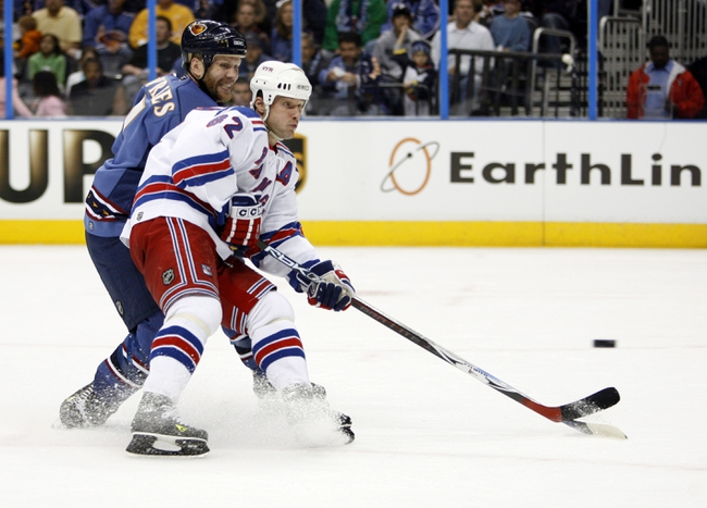 Apr 14, 2007; Atlanta, GA, USA; New York Rangers forward (82) Martin Straka deflects a puck towards the net in front of Atlanta Thrashers defenseman (7) Greg de Vries in the second period at Philips Arena in the Eastern Conference Quarterfinal playoff series. The Rangers defeated the Thrashers 2 to 1 to take a two games to none lead in the best of seven series. Mandatory Credit: Dale Zanine USA TODAY Sports Copyright (c) 2007 Dale Zanine