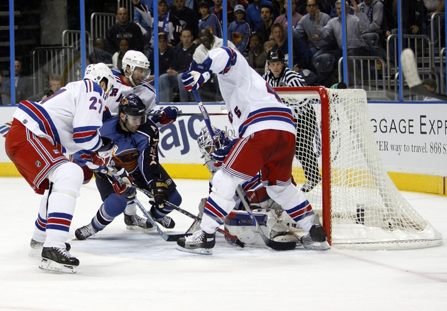 Apr 14, 2007; Atlanta, GA, USA; Atlanta Thrashers forward (9) Pascal Dupuis jabs at a rebound left by New York Rangers goalie (30) Henrik Lundqvist while being defended by Rangers defenseman (27) Paul Mara in the third period at Philips Arena in the Eastern Conference Quarterfinal playoff series. The Rangers defeated the Thrashers 2 to 1 to take a two games to none lead in the best of seven series. Mandatory Credit: Dale Zanine USA TODAY Sports Copyright (c) 2007 Dale Zanine