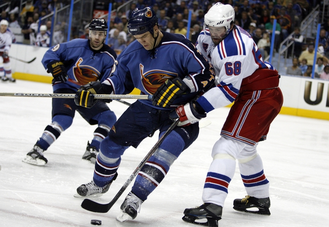 Apr 14, 2007; Atlanta, GA, USA; Atlanta Thrashers forward (16) Bobby Holik battles for possession of the puck with New York Rangers forward (68) Jaromir Jagr in the second period at Philips Arena in the Eastern Conference Quarterfinal playoff series. The Rangers defeated the Thrashers 2 to 1 to take a two games to none lead in the best of seven series. Mandatory Credit: Dale Zanine USA TODAY Sports Copyright (c) 2007 Dale Zanine