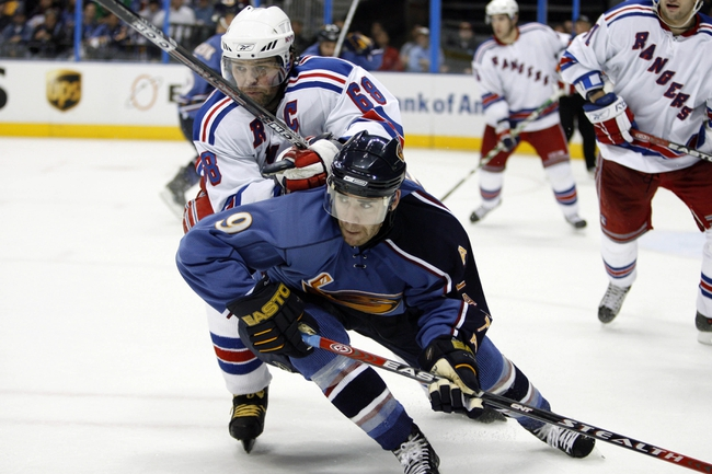 Apr 14, 2007; Atlanta, GA, USA; Atlanta Thrashers forward (9) Pascal Dupuis is checked from behind by N