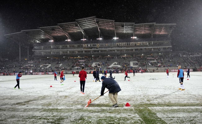 Mar 22, 2013; Commerce City, CO, USA; A worker clears snow from the field prior to game between the USA and Costa Rica at Dick's Sporting Goods Park. Mandatory Credit: Byron Hetzler-USA TODAY Sports