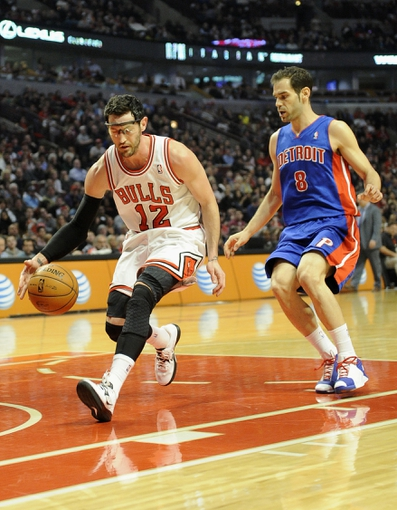 Mar 31, 2013; Chicago, IL, USA; Chicago Bulls shooting guard Kirk Hinrich (12) controls the ball as Detroit Pistons point guard Jose Calderon (8) defends during the first half at the United Center. Mandatory Credit: David Banks-USA TODAY Sports