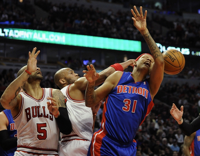 Mar 31, 2013; Chicago, IL, USA; Detroit Pistons power forward Charlie Villanueva (31) is defended by Chicago Bulls power forward Carlos Boozer (5) and power forward Taj Gibson (22) during the first half at the United Center. Mandatory Credit: David Banks-USA TODAY Sports