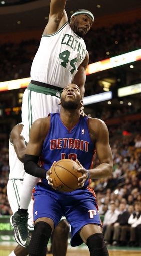 Apr 3, 2013; Boston, MA, USA; Detroit Pistons center Greg Monroe tries to get around Boston Celtics forward Chris Wilcox (44) during the first quarter of an NBA game. Mandatory Credit: Winslow Townson-USA TODAY Sports