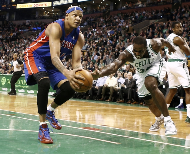 Apr 3, 2013; Boston, MA, USA; Boston Celtics forward Brandon Bass tries to steal the ball from Detroit Pistons forward Charlie Villanueva during the second quarter of an NBA game at TD Garden. Mandatory Credit: Winslow Townson-USA TODAY Sports