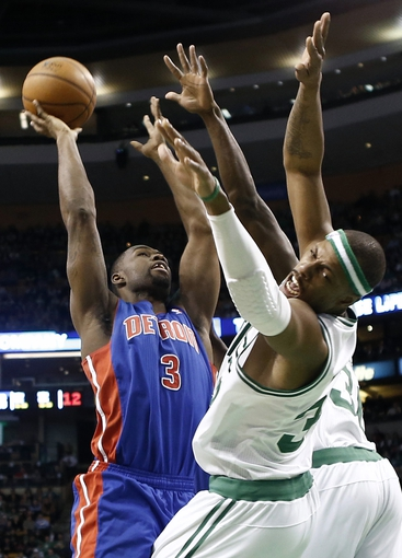 Apr 3, 2013; Boston, MA, USA; Boston Celtics forward Paul Pierce is knocked backwards as Detroit Pistons guard Rodney Stuckey goes for a shot during the second quarter of an NBA game at TD Garden. Mandatory Credit: Winslow Townson-USA TODAY Sports