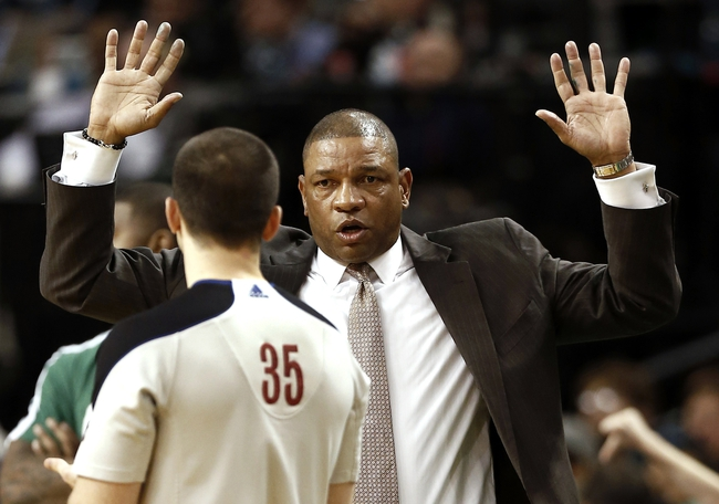 Apr 3, 2013; Boston, MA, USA; Boston Celtics head coach Doc Rivers talks with a referee during the fourth quarter of Boston's 98-93 win over the Detroit Pistons in an NBA game at TD Garden. Mandatory Credit: Winslow Townson-USA TODAY Sports