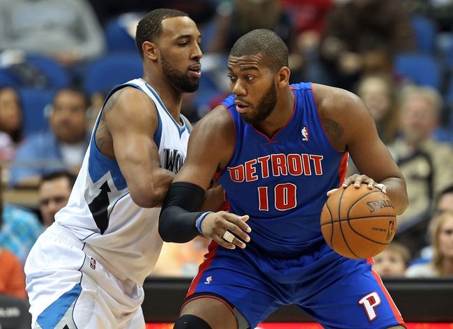 Apr 6, 2013; Minneapolis, MN, USA; Detroit Pistons center Greg Monroe (10) attempts to drive to the basket on Minnesota Timberwolves power forward Derrick Williams (7) in the first half at Target Center. Mandatory Credit: Jesse Johnson-USA TODAY Sports