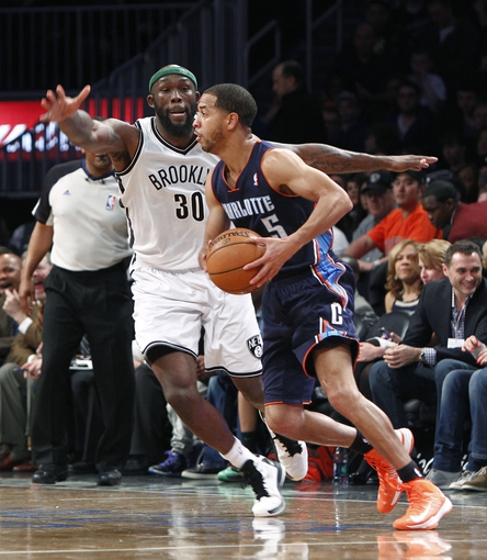 Apr 6, 2013; Brooklyn, NY, USA; Brooklyn Nets forward Reggie Evans (30) defends against Charlotte Bobcats guard Jannero Pargo (5) in the fourth quarter at Barclays Center. Nets won 105-96. Mandatory Credit: Nicole Sweet-USA TODAY Sports