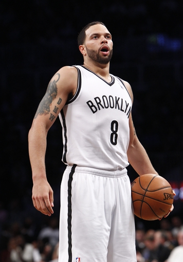 Apr 6, 2013; Brooklyn, NY, USA; Brooklyn Nets guard Deron Williams (8) in the fourth quarter against Charlotte Bobcats at Barclays Center. Nets won 105-96. Mandatory Credit: Nicole Sweet-USA TODAY Sports