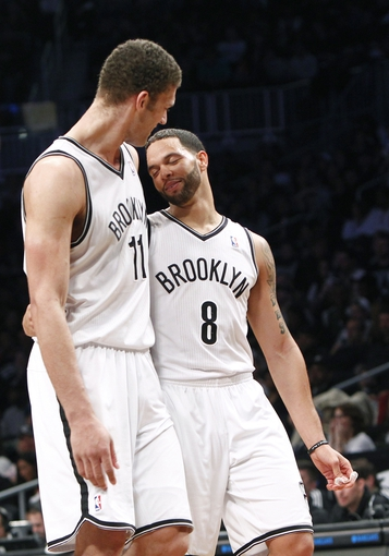 Apr 6, 2013; Brooklyn, NY, USA; Brooklyn Nets center Brook Lopez (11) and guard Deron Williams (8) in the fourth quarter against Charlotte Bobcats at Barclays Center. Nets won 105-96. Mandatory Credit: Nicole Sweet-USA TODAY Sports
