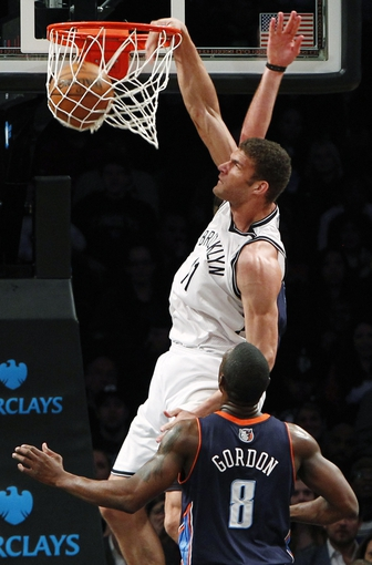 Apr 6, 2013; Brooklyn, NY, USA; Brooklyn Nets center Brook Lopez (11) dunks the ball against Charlotte Bobcats guard Ben Gordon (8) in the second quarter at Barclays Center. Nets won 105-96. Mandatory Credit: Nicole Sweet-USA TODAY Sports