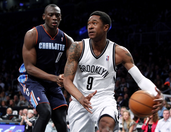 Apr 6, 2013; Brooklyn, NY, USA; Brooklyn Nets guard MarShon Brooks (9) looks to pass the ball against Charlotte Bobcats forward Bismack Biyombo (0) in the fourth quarter at Barclays Center. Nets won 105-96. Mandatory Credit: Nicole Sweet-USA TODAY Sports