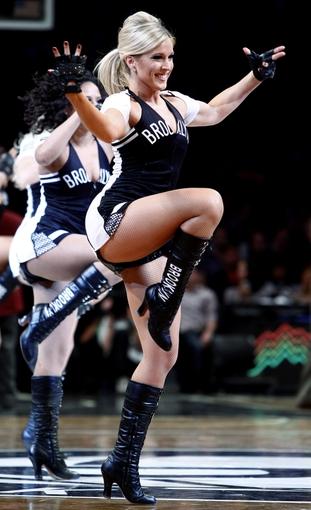 Apr 6, 2013; Brooklyn, NY, USA; Members of the Brooklynettes dance team perform during the fourth quarter at the game between the Charlotte Bobcats and the Brooklyn Nets at Barclays Center. Nets won 105-96. Mandatory Credit: Nicole Sweet-USA TODAY Sports