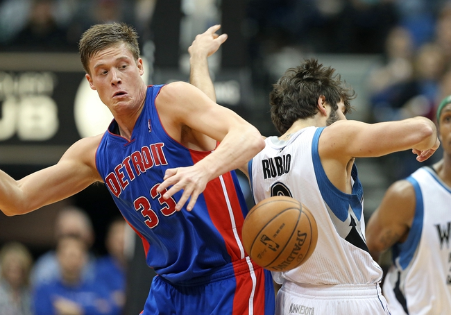 Apr 6, 2013; Minneapolis, MN, USA; Detroit Pistons power forward Jonas Jerebko (33) fights for a loose ball with Minnesota Timberwolves point guard Ricky Rubio (9) in the second half at Target Center. The Timberwolves won 107-101. Mandatory Credit: Jesse Johnson-USA TODAY Sports