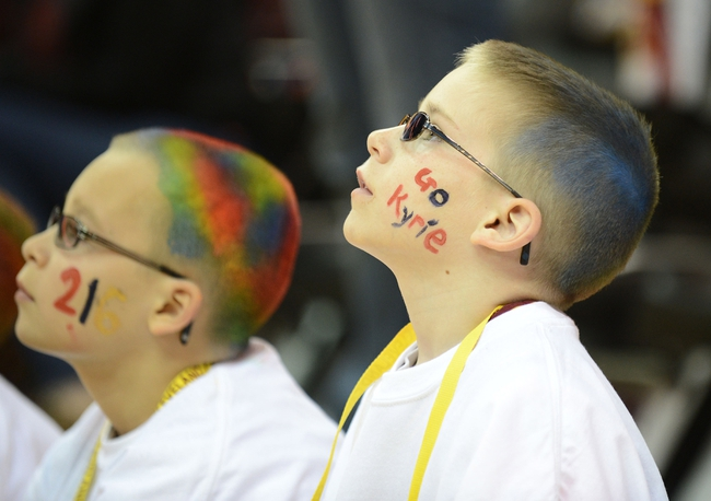 Apr 7, 2013; Cleveland, OH, USA; A young Cleveland Cavaliers fan watches warm ups prior to the game between the Cleveland Cavaliers and the Orlando Magic at Quicken Loans Arena. Mandatory Credit: Eric P. Mull-USA TODAY Sports