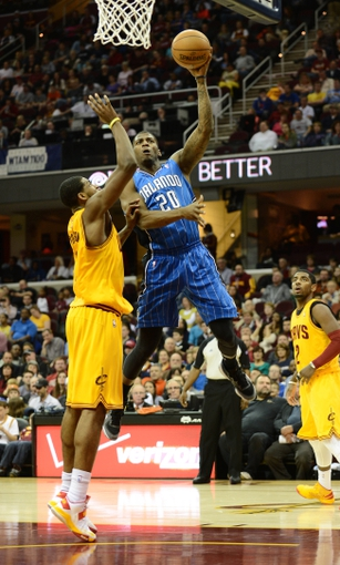 Apr 7, 2013; Cleveland, OH, USA; Orlando Magic small forward DeQuan Jones (20) goes up for a shot as Cleveland Cavaliers power forward Tristan Thompson (13) defends during the game at Quicken Loans Arena. Mandatory Credit: Eric P. Mull-USA TODAY Sports
