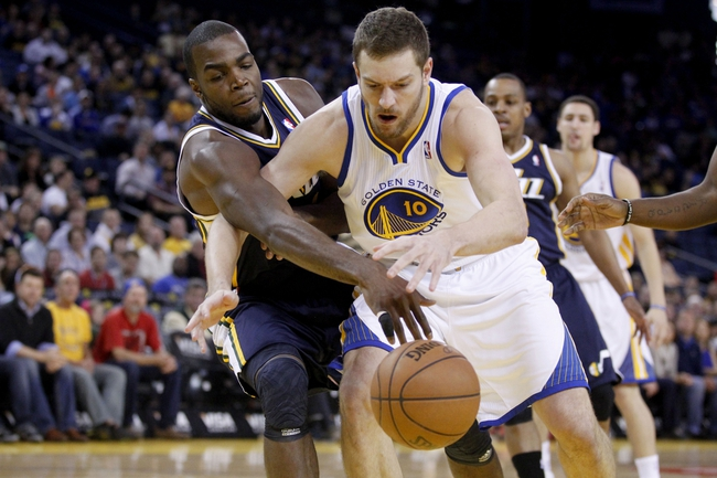 Apr 7, 2013; Oakland, CA, USA; Golden State Warriors forward David Lee (10) tries to catch a pass in front of Utah Jazz forward Paul Millsap (24) in the first quarter at ORACLE arena. Mandatory Credit: Cary Edmondson-USA TODAY Sports