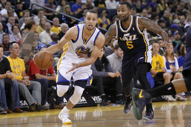 Apr 7, 2013; Oakland, CA, USA; Golden State Warriors guard Stephen Curry (30) drives past Utah Jazz guard Mo Williams (5) in the first quarter at ORACLE arena. Mandatory Credit: Cary Edmondson-USA TODAY Sports
