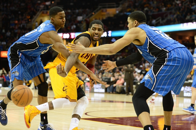 Apr 7, 2013; Cleveland, OH, USA; Cleveland Cavaliers point guard Kyrie Irving (2) passes the ball against the Orlando Magic during the game at Quicken Loans Arena. Mandatory Credit: Eric P. Mull-USA TODAY Sports