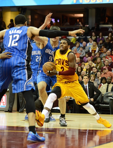 Apr 7, 2013; Cleveland, OH, USA; Cleveland Cavaliers point guard Kyrie Irving (2) drives to the basket against the Orlando Magic during the game at Quicken Loans Arena. Mandatory Credit: Eric P. Mull-USA TODAY Sports