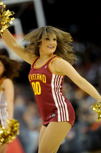 Apr 7, 2013; Cleveland, OH, USA; A member of the Cleveland Cavalier girls cheers during a timeout in the game against the Orlando Magic at Quicken Loans Arena. Mandatory Credit: Eric P. Mull-USA TODAY Sports