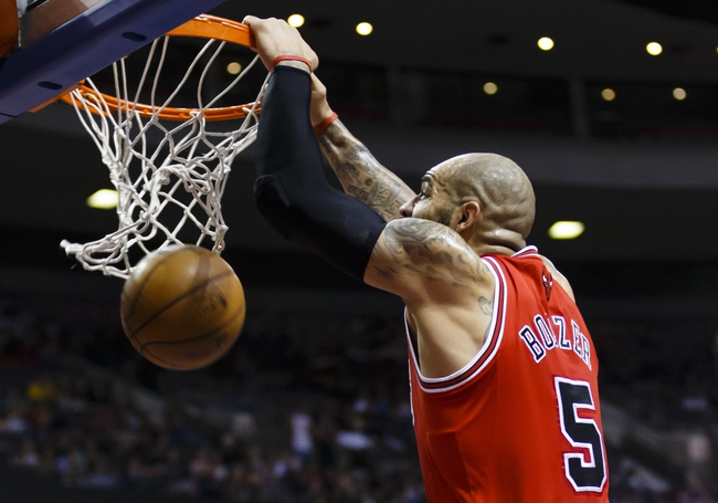 April 7, 2013; Auburn Hills, MI, USA; Chicago Bulls power forward Carlos Boozer (5) dunks the ball in the first quarter against the Detroit Pistons at The Palace. Mandatory Credit: Rick Osentoski-USA TODAY Sports