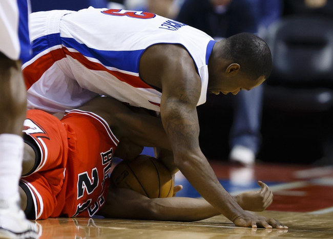 April 7, 2013; Auburn Hills, MI, USA; Detroit Pistons point guard Rodney Stuckey (3) and Chicago Bulls small forward Jimmy Butler (21) go after the ball in the second quarter at The Palace. Mandatory Credit: Rick Osentoski-USA TODAY Sports