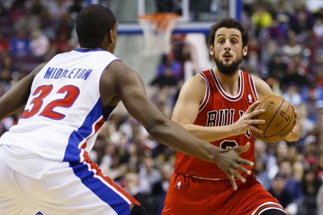 April 7, 2013; Auburn Hills, MI, USA; Chicago Bulls shooting guard Marco Belinelli (8) is guarded by Detroit Pistons small forward Khris Middleton (32) in the second quarter at The Palace. Mandatory Credit: Rick Osentoski-USA TODAY Sports