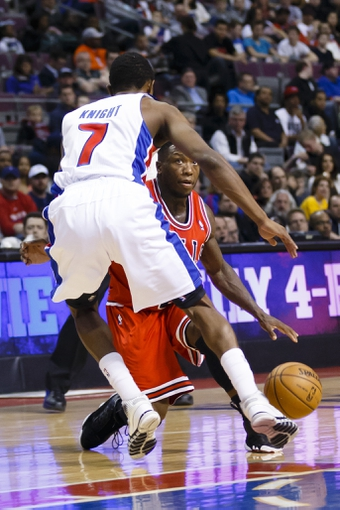 April 7, 2013; Auburn Hills, MI, USA; Chicago Bulls point guard Nate Robinson (2) is guarded by Detroit Pistons point guard Brandon Knight (7) in the first quarter at The Palace. Mandatory Credit: Rick Osentoski-USA TODAY Sports