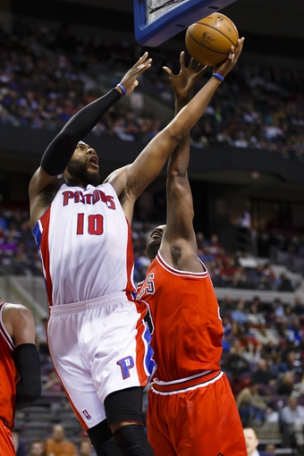 April 7, 2013; Auburn Hills, MI, USA; Detroit Pistons center Greg Monroe (10) goes to the basket on Chicago Bulls center Nazr Mohammed (48) in the third quarter at The Palace. Detroit won 99-85. Mandatory Credit: Rick Osentoski-USA TODAY Sports