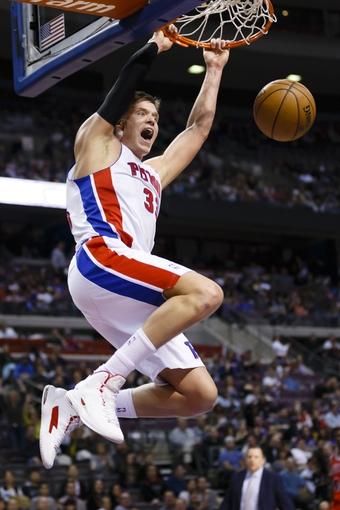 April 7, 2013; Auburn Hills, MI, USA; Detroit Pistons power forward Jonas Jerebko (33) dunks the ball in the fourth quarter against the Chicago Bulls at The Palace. Detroit won 99-85. Mandatory Credit: Rick Osentoski-USA TODAY Sports
