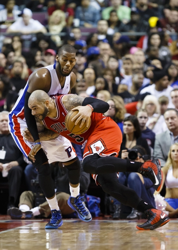 April 7, 2013; Auburn Hills, MI, USA; Chicago Bulls power forward Carlos Boozer (5) is guarded by Detroit Pistons center Greg Monroe (10) in the third quarter at The Palace. Mandatory Credit: Rick Osentoski-USA TODAY Sports