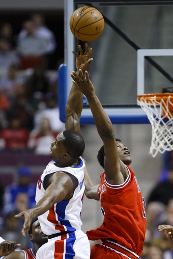 April 7, 2013; Auburn Hills, MI, USA; Detroit Pistons point guard Rodney Stuckey (3) and Chicago Bulls small forward Jimmy Butler (21) do a jump ball in the first quarter at The Palace. Mandatory Credit: Rick Osentoski-USA TODAY Sports