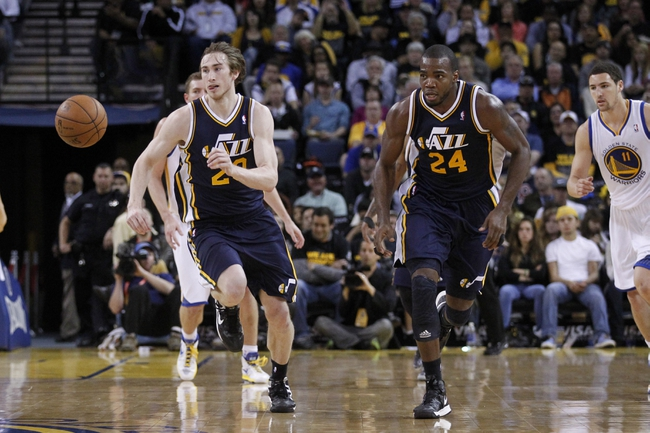 Apr 7, 2013; Oakland, CA, USA; Utah Jazz guard Gordan Hayward (20) chases down a loose ball next to forward Paul Millsap (24) against the Golden State Warriors in the third quarter at ORACLE arena. The Jazz defeated the Warriors 97-90. Mandatory Credit: Cary Edmondson-USA TODAY Sports