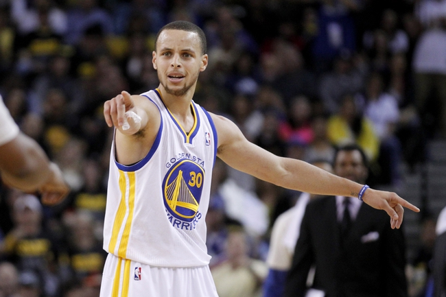 Apr 7, 2013; Oakland, CA, USA; Golden State Warriors guard Stephen Curry (30) reacts after a foul was called against the Warriors during action against the Utah Jazz in the fourth quarter at ORACLE arena. The Jazz defeated the Warriors 97-90. Mandatory Credit: Cary Edmondson-USA TODAY Sports