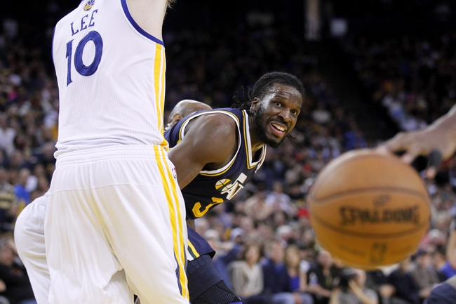 Apr 7, 2013; Oakland, CA, USA; Utah Jazz forward DeMarre Carroll (3) watches the ball after making a pass around Golden State Warriors forward David Lee (10) in the fourth quarter at ORACLE arena. The Jazz defeated the Warriors 97-90. Mandatory Credit: Cary Edmondson-USA TODAY Sports