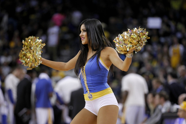 Apr 7, 2013; Oakland, CA, USA; A cheerleader from the Golden State Warriors performs during a timeout against the Utah Jazz in the fourth quarter at ORACLE arena. The Jazz defeated the Warriors 97-90. Mandatory Credit: Cary Edmondson-USA TODAY Sports