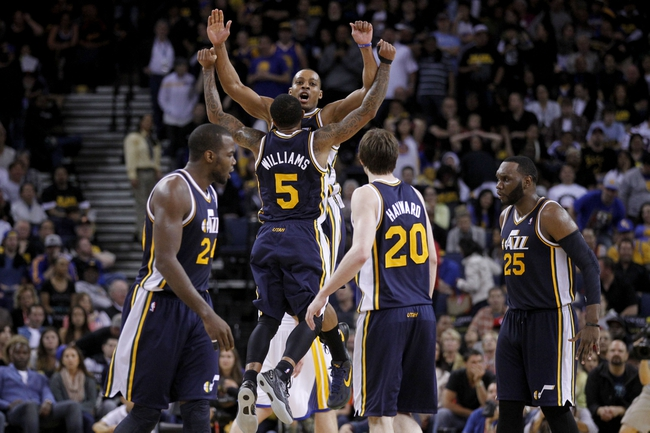 Apr 7, 2013; Oakland, CA, USA; Utah Jazz guard Mo Williams (5) is congratulated by guard Randy Foye (8) after Williams made a three point basket against the Golden State Warriors in the fourth quarter at ORACLE arena. The Jazz defeated the Warriors 97-90. Mandatory Credit: Cary Edmondson-USA TODAY Sports