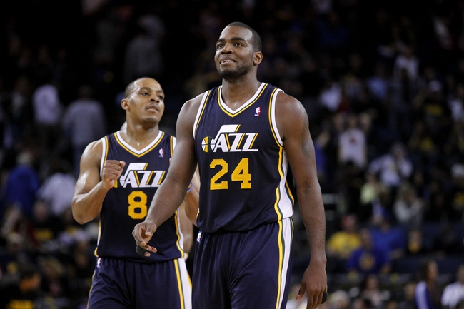 Apr 7, 2013; Oakland, CA, USA; Utah Jazz forward Paul Millsap (24) smiles after drawing a foul against the Golden State Warriors in the fourth quarter at ORACLE arena. The Jazz defeated the Warriors 97-90. Mandatory Credit: Cary Edmondson-USA TODAY Sports
