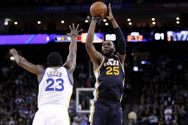 Apr 7, 2013; Oakland, CA, USA; Utah Jazz center Al Jefferson (25) makes a shot over Golden State Warriors forward Draymond Green (23) with just over two minutes remaining in the fourth quarter at ORACLE arena. The Jazz defeated the Warriors 97-90. Mandatory Credit: Cary Edmondson-USA TODAY Sports
