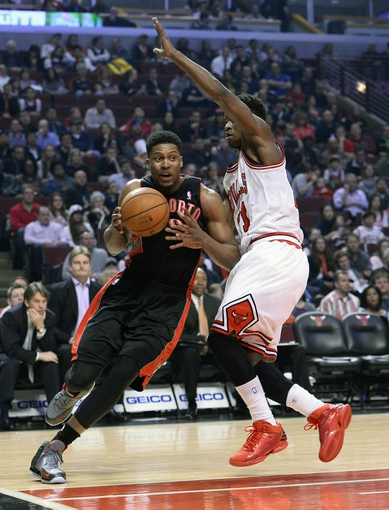 Apr 9, 2013; Chicago, IL, USA; Toronto Raptors small forward Rudy Gay (22) dribbles the ball against Chicago Bulls small forward Jimmy Butler (21) during the first half at the United Center. Mandatory Credit: Mike DiNovo-USA TODAY Sports
