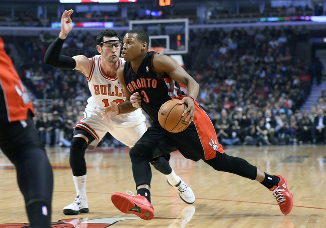 Apr 9, 2013; Chicago, IL, USA; Toronto Raptors point guard Kyle Lowry (3) dribbles the ball against Chicago Bulls shooting guard Kirk Hinrich (12) during the first half at the United Center. Mandatory Credit: Mike DiNovo-USA TODAY Sports