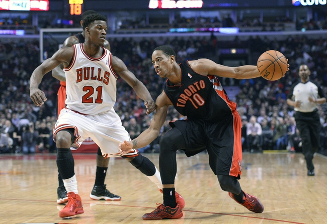 Apr 9, 2013; Chicago, IL, USA; Toronto Raptors shooting guard DeMar DeRozan (10) dribbles the ball against Chicago Bulls small forward Jimmy Butler (21) during the first half at the United Center. Mandatory Credit: Mike DiNovo-USA TODAY Sports