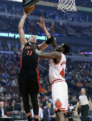 Apr 9, 2013; Chicago, IL, USA; Toronto Raptors center Jonas Valanciunas (17) shoots the ball against Chicago Bulls center Nazr Mohammed (48) during the first half at the United Center. Mandatory Credit: Mike DiNovo-USA TODAY Sports